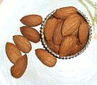 100 grams of almonds have 173% RDA  of vitamin E.  100 grams is a lot of almonds though, usually a serving of nuts is 1/4 a cup which is 30 grams.  So if you eat about 30 grams you are still getting almost 50% of the rda of vitamin E