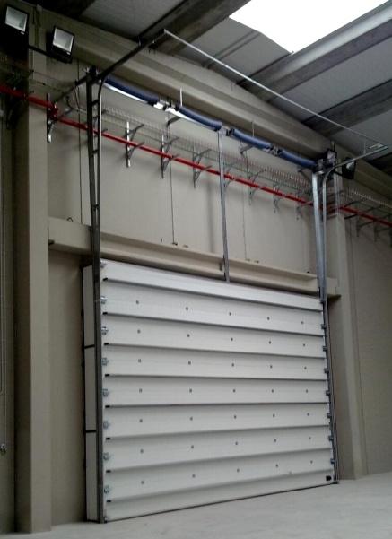 #Puertas #seccional con paneles #sandwich #AngelMir en la empresa #Persianas Hernando #Segovia #Espana #Spain