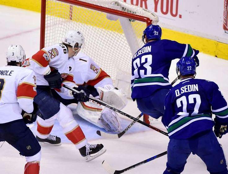 Sedin scored 1000th NHL point:   The Canucks' Henrik Sedin scores his 1000th NHL point against the Panthers goaltender Roberto Luongo Jan. 20 in Vancouver. The Canucks won 2‐1.