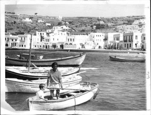 OCT 29 1961 Greek Island of Mykonos Spreads Out Beyond its Fishing Village, Harbor President Kennedy's wife was among the 21,247 visitors during first half of year. Credit: AP Newsfeature Photos .| eBay