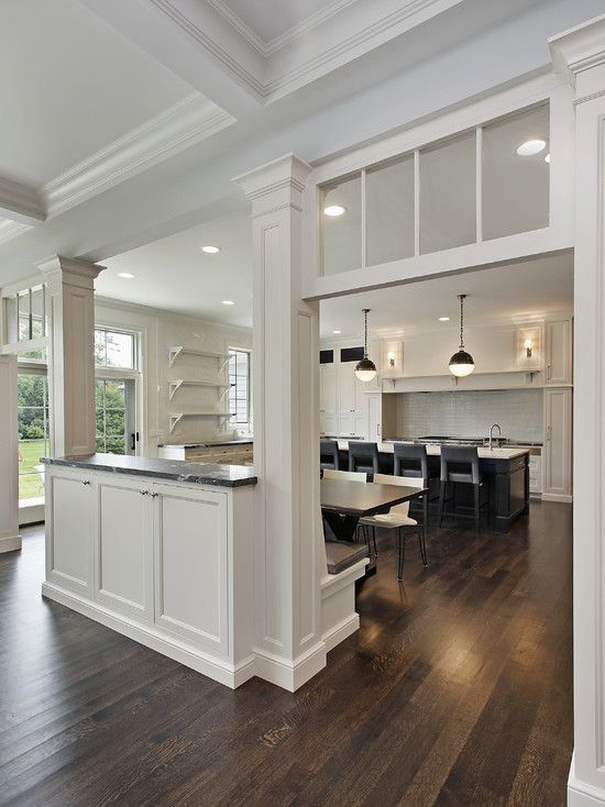 Oxford Development: Elegant, traditional kitchen design with transom windows and pass through. White ...