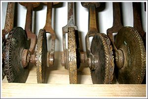 a small collectio of antique bookbinding tools for creating bespoke books