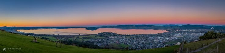 This is a nine frame panorama taken just after sunset from the view up at Aorangi Peak Restaurant. Mark Smith and …