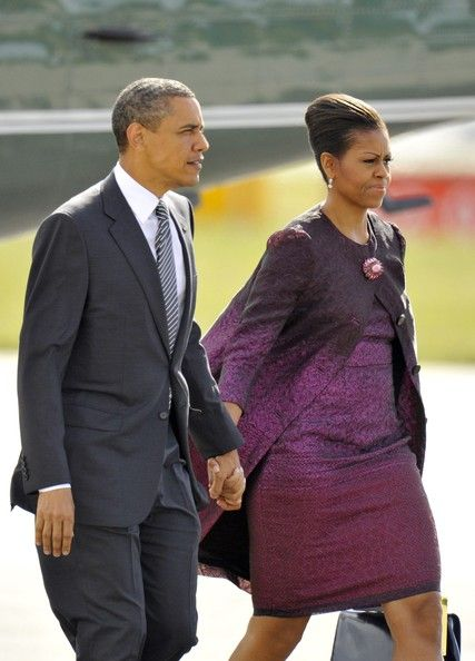 Michelle Obama Cocktail Dress     Michelle looked lovely leaving the UK in a purple ombre jacquard cocktail dress and matching coat.   Brand: Peter Som
