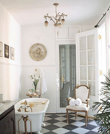 Designs and styles come and go but some things remain timelessly chic- clawfoot tubs and black & white marble floors to name a few