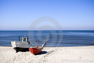 Two fishing boats standing on the sand of a beach. Clear sky and horizon, nobody in the photo. The Baltic Sea.  <a href='http://www.dreamstime.com/baltic-sea-scenics.-seaside-towns-and-villages-as-well.-rcollection3976-resi208938' STYLE='font-size:13px; text-decoration: blink; color:#FF0000'><b>MORE BALTIC PHOTOS »</b></a>