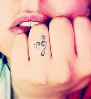 Music note ring finger tattoo