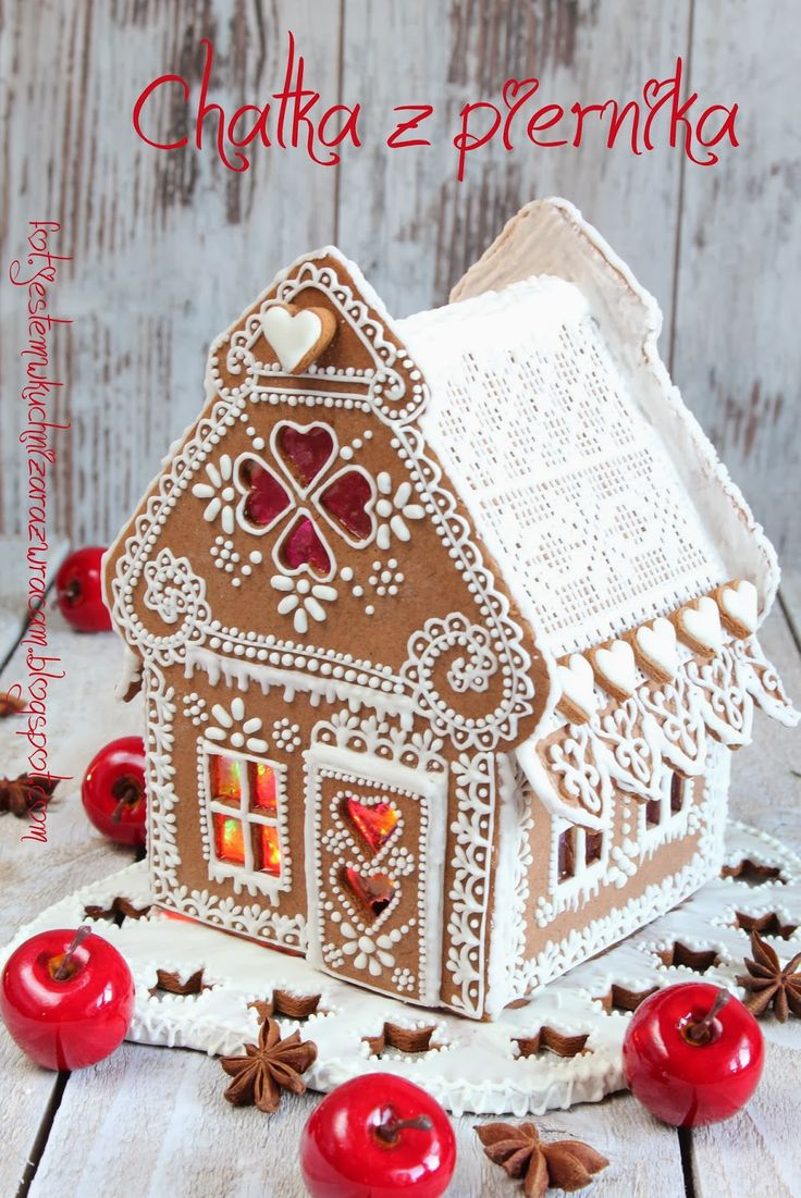Gingerbread house decorated with white icing love the windows