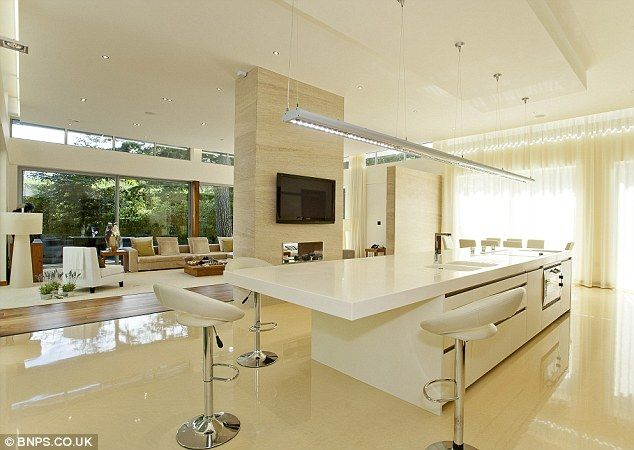 Luxury breakfast bar: The seated dining area and open-plan living room which is bigger than an average three-bedroom apartment on its own