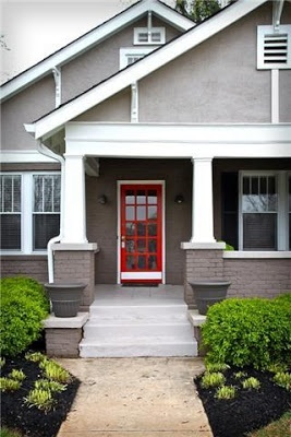 Red door on a gray house.... a classic combination.
