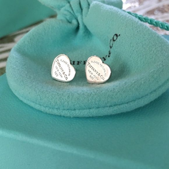 Tiffany and co rtt heart earring studs 100% authentic. These are the small original return to Tiffany earring studs. Come with authentic original butterfly backings hallmarked tco. .925 sterling silver comes in original pouch. Tiffany & Co. Jewelry Earrings