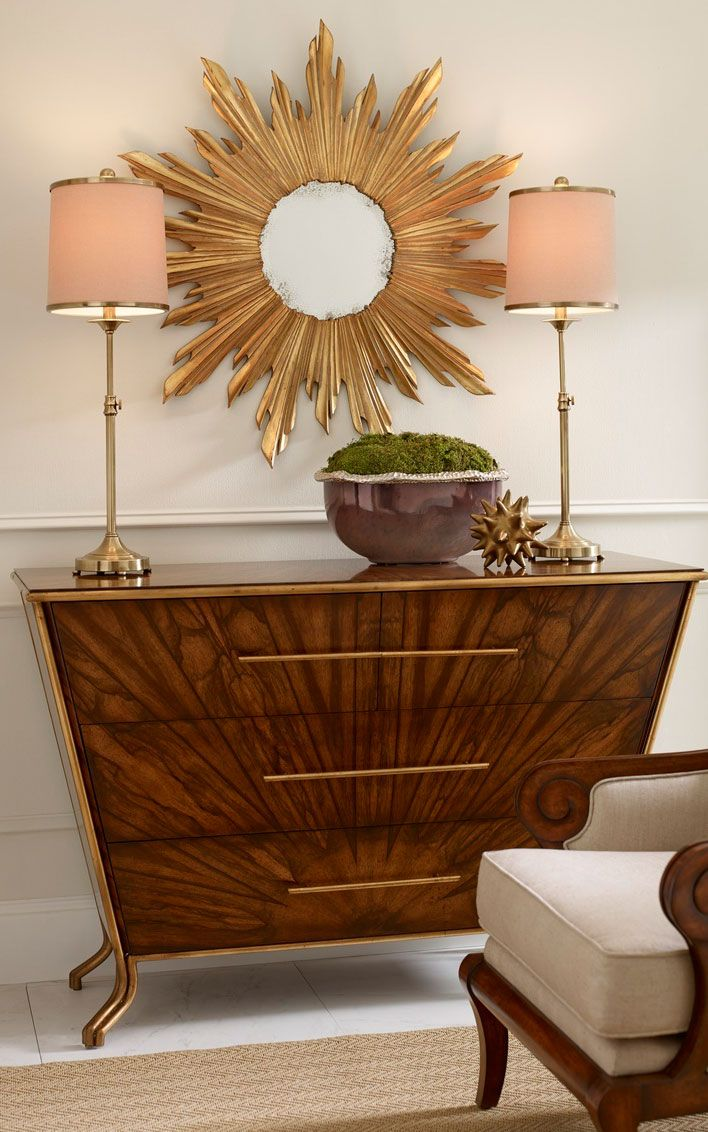 Elegant Interior Setting Featuring Sleek Contemporary Chest Pair Of Slender Adjustable Brass Lamps And Sunburst
