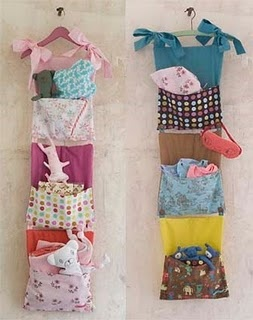 I like the idea of the left hand one- pockets with different little soft toys in.