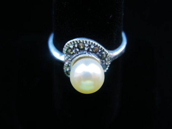 Check out this item in my Etsy shop https://www.etsy.com/listing/207291748/vintage-sterling-silver-pearl-ring