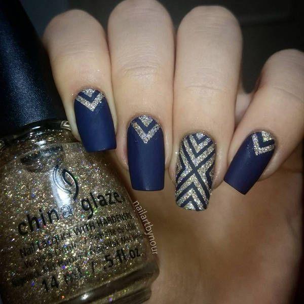 Dark blue matte nails with glitter gold design