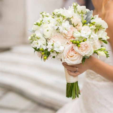 pale pink and white bridal bouquet blush garden roses dusty miller hypericum berries