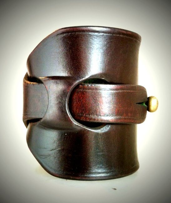 This is a beautiful leather cuff bracelet. I've had a favorite cuff since 2011. It's smaller than this with copper embellishments.
