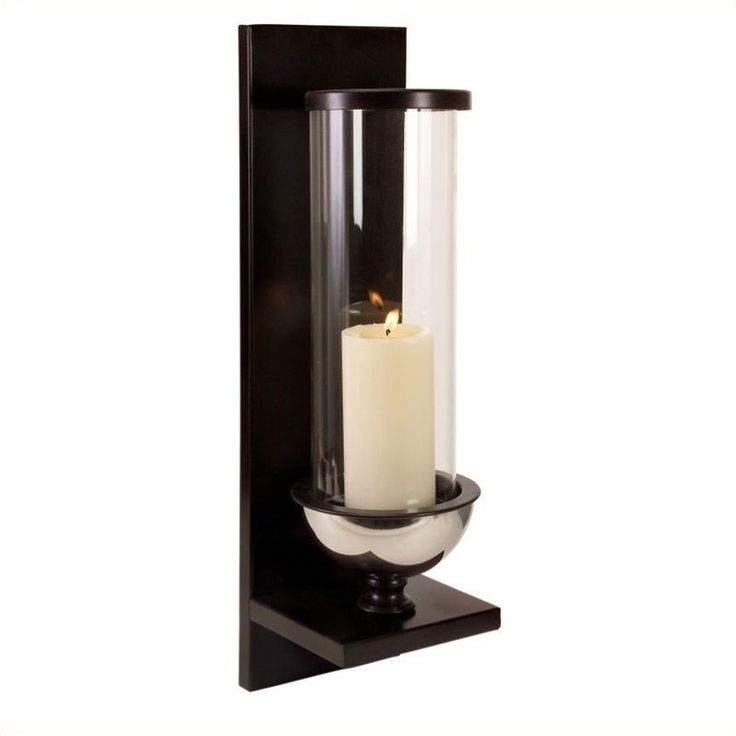 modern silver metal and glass wall sconce holds pillar candle glass cylinder is tall and slender clean lines in the wall mount complete a modern
