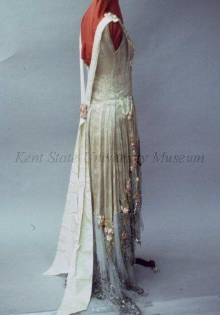 Dress (image 2)   Attributed to House of Boue Soeurs   French   1928   Brocade silver lame, blue net, silk floral trim, sequins. Possible robe de style dress, missing panniers.   Kent State University Museum   Object No.: 1983.001.0305