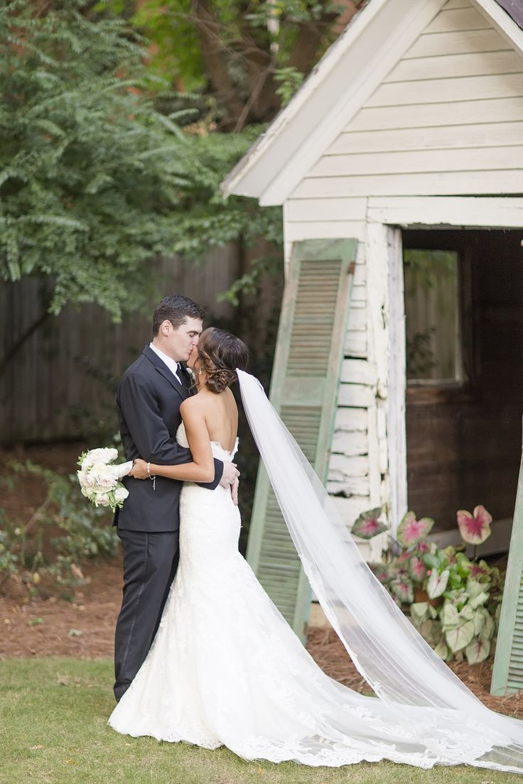 Classic bridal fashion, chapel-length veil, strapless wedding dress, up-do // Laura Anne Watson