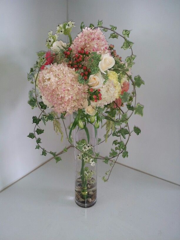 Corporate function or wedding centerpiece. Roses, hydrangea, hypericum and ornithogallum