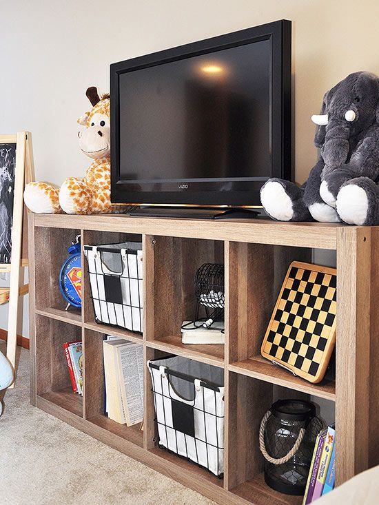 By placing this rustic 8-cube organizer in her family's playroom, Cherished Bliss blogger Ashley created a media center that holds not only a TV, but also her kids' books, toys, and games. A couple deep baskets fit perfectly in the cubbies and make cleanup a breeze./