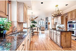nice color combination in granite and wood; floors look too striped though