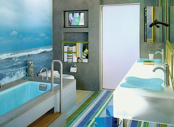 Cute kid's bathroom, no? Like the steps to the tub, and the flower design sinks...and the towel holders!