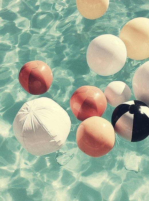 Colorful beach balls in a Palm Springs pool by Christine Flynn Photography.