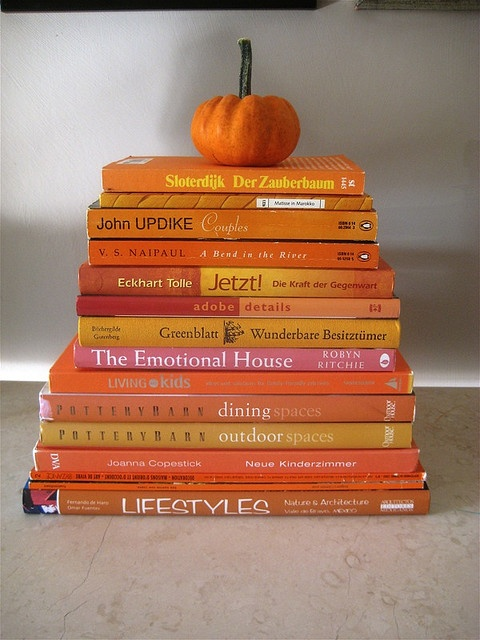 stacks of orange books