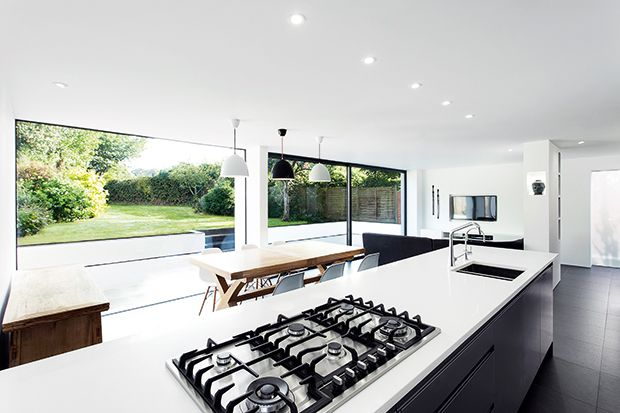 an open plan kitchen living and dining room in an extension to 1950s home