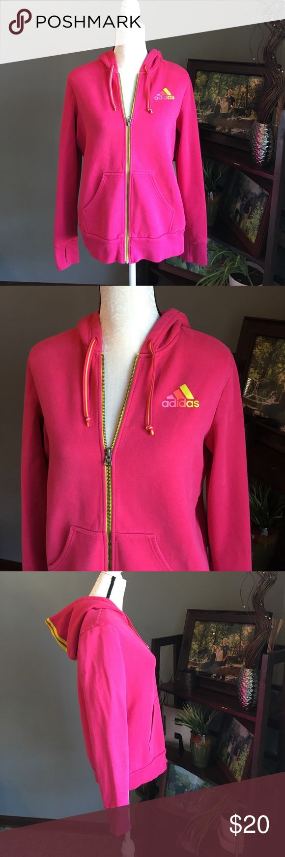 "ADIDAS Zip Up Hoodie Adidas Zip Up hoodie.  Size L. Pink with neon yellow trim.  Adidas logo on chest is pink, orange, and yellow.  Hood has 3 yellow Adidas stripes.  There is a small stain on the hood (shown in pictures) but otherwise this is in great shape.  Cuffs have thumb holes. Very comfortable! Made of 70% cotton and 30% polyester.  Measures about 26"" from shoulder to bottom hem and about 22"" across the chest laying flat unstretched. Offers and bundles welcome! adidas Tops Sweatshirts…"