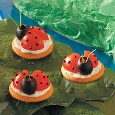 ladybugs on crakers, don't worry the ladybugs are OK to eat.