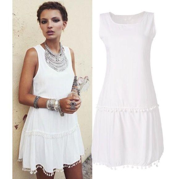 White Boho Sundress White dress with white Pom Pom balls at the bottom of the dress and just below the waist Dresses Mini