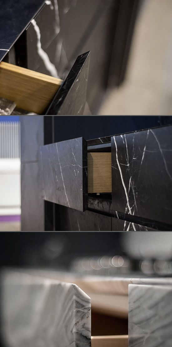 Monolith from piqu is a contemporary kitchen designed to appear as one solid piece of stone - a key feature of this is the mitred drawer and worksurface edges allowing minimal gaps between panels. Here in nero marquina marble and Australian marble.