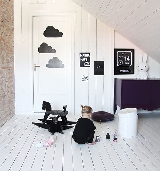 I love the way monochrome nurseries allow details to stand out such as the cloud wall stickers and the bunny lamp. Subtle elements such as these can be lost in busier or very colourful rooms. :: KOKO KIDS :: #monochrome #monochromenursery #monochromerooms