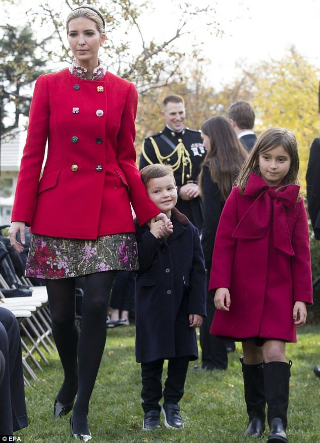 Mama's boy: Ivanka held her eldest son's hand as they walked to their seats for the ceremony of pardoning the Thanksgiving Turkey . Trump daughter and grandchildren
