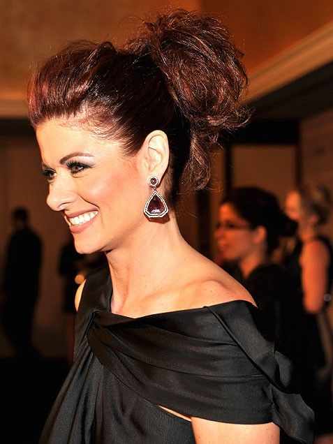 Debra Messing employs a subtle pouf to give her hair height in the front, then teases the back into a voluminous bun.