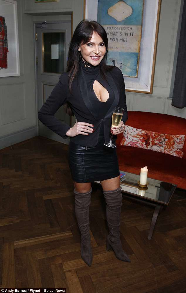 Lizzie Cundy Flaunts Her Curves In A Racy Black Top And Leather