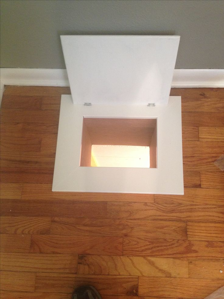 Laundry chute in the floor.