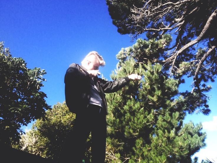 Ethan miming aiming down a gun at Featherston