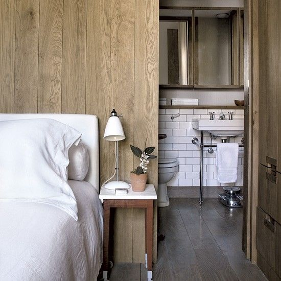 Bedroom with ensuite bathroom - hide ensuite behind bed - good idea....