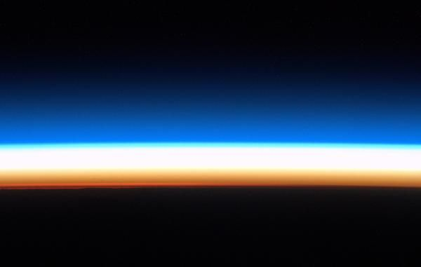 The Earth's horizon, just before sunrise. Beautiful lines of colour, a rainbow halo for the planet.
