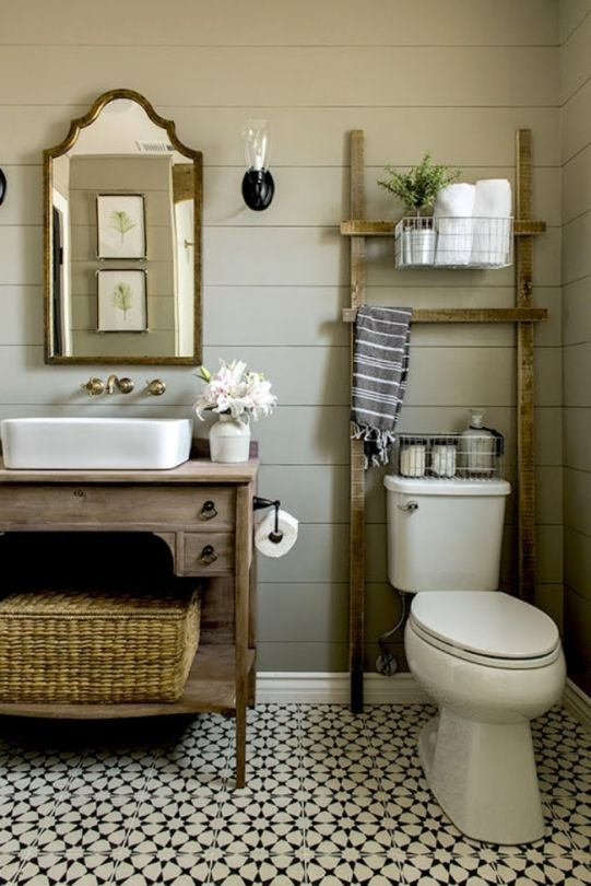 The dream home everybody wants: This popular bathroom is a little more rustic, using vintage pieces and patterned tiles to add character to the timber pannelled room.