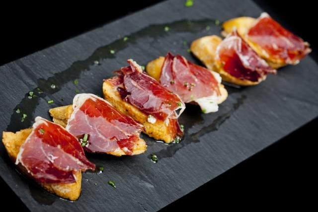 We all love tapas-- but what are tapas really? Find out the origin of Spanish tapas, and discover how they vary from town to town. Then make your own!
