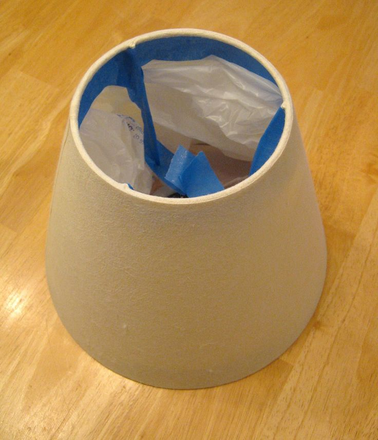 keep it professional by taping a bag inside your lampshade before you spray paint it...