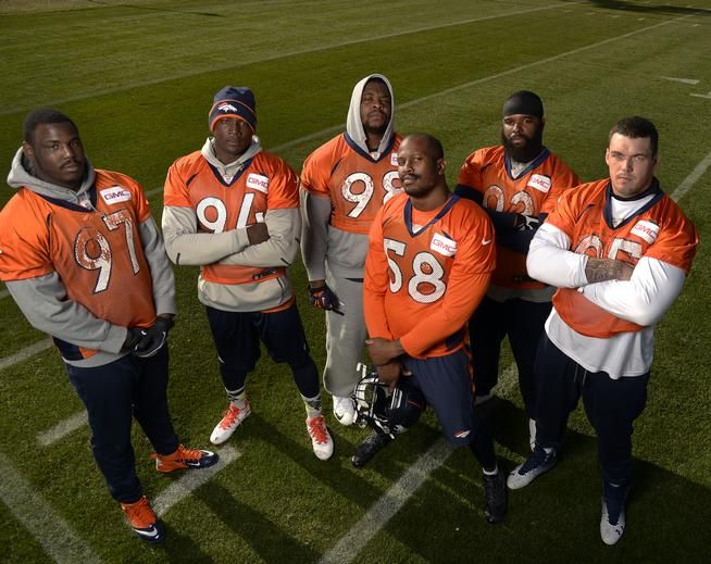 Denver Broncos defensive lineman Malik Jackson, DeMarcus Ware, Terrance Knighton, Von Miller, Sylvester Williams and Derek Wolfe pose after practice