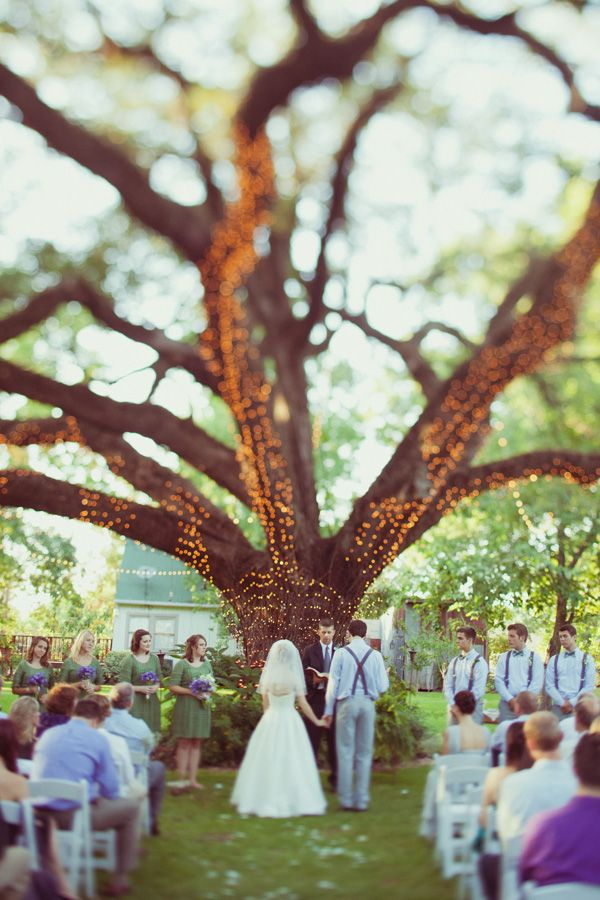 """wow!  we want to do this, but I""""m also thinking about a single chandelier OR lots of candles hanging under the tree"""