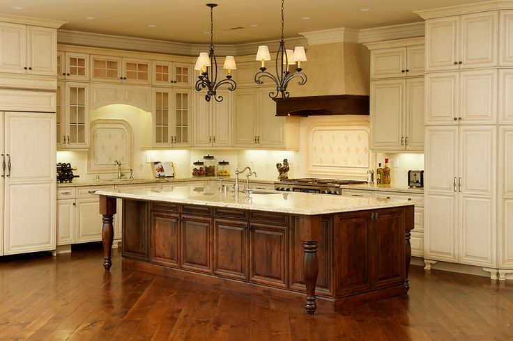 Dura supreme venice.  Island is knotty alder in mission.  Cabinets are maple in antique white with espresso glaze.