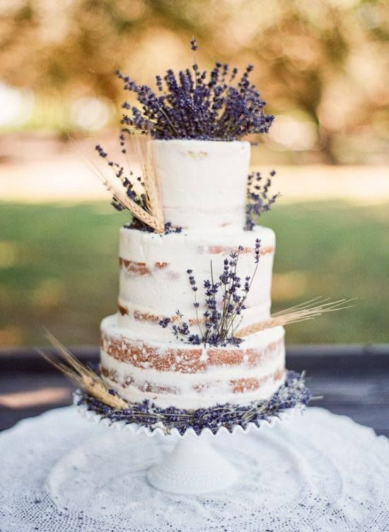 It is becoming popular to show some of the natural cake through the icing - 'naked cake'.  I love this design with the lavender spikes.